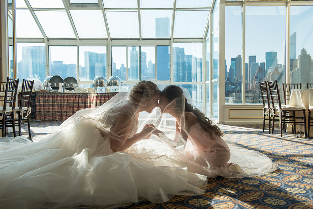 Romantic meaningful moment between a bride and a maid of honor.